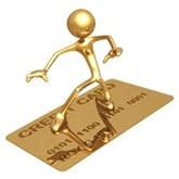 Gold figure riding a credit card