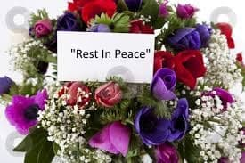 "Bouquet of flowers with ""Rest In Peace"" card"