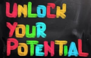 Unlock your potential sign in rainbow colours