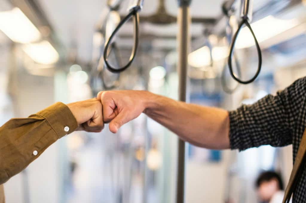 www.mastermortgagebrokersydney.com.au - two guys joining clenched fists together as a sign of frriendship